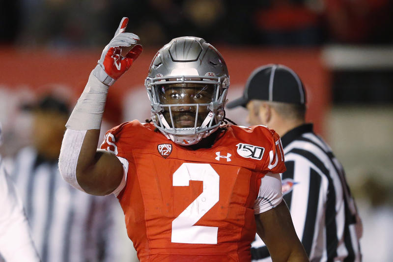 Utah running back Zack Moss celebrates after a touchdown against UCLA during the first half of an NCAA college football game Saturday, Nov. 16, 2019, in Salt Lake City. (AP Photo/Rick Bowmer)