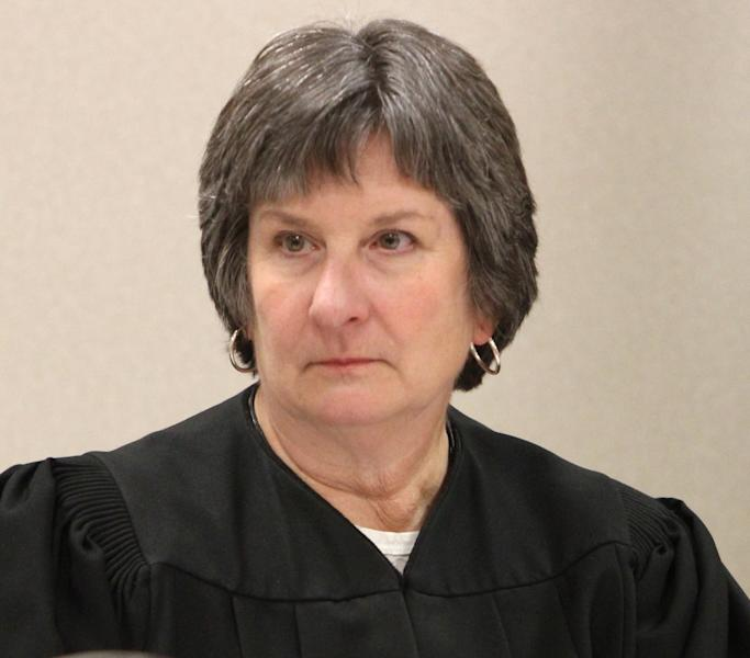 Superior Court Judge Anna M. Laurie presides over the juvenile detention hearing of the 9-year-old boy accused of accidentally shooting a classmate at a Bremerton, Wash. elementary school, in Kitsap County, Wash. Thursday, Feb. 23, 2012. Authorities say the boy brought a handgun to school Wednesday and the weapon discharged from inside his backpack, critically wounding 8-year-old Amina Kocer-Bowman. (AP Photo/The Seattle Times, Ken Lambert, Pool)