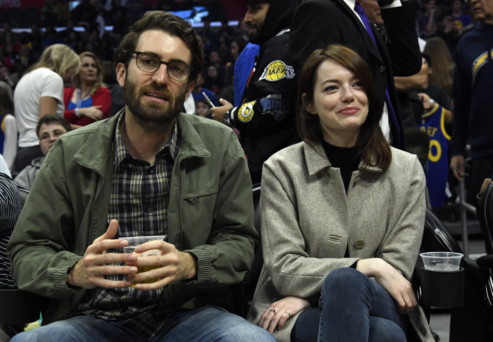 LOS ANGELES, CA - JANUARY 18: Emma Stone and Dave McCary attend the Golden State Warriors and Los Angeles Clippers basketball game at Staples Center on January 18, 2019 in Los Angeles, California. NOTE TO USER: User expressly acknowledges and agrees that, by downloading and or using this photograph, User is consenting to the terms and conditions of the Getty Images License Agreement. (Photo by Kevork Djansezian/Getty Images)