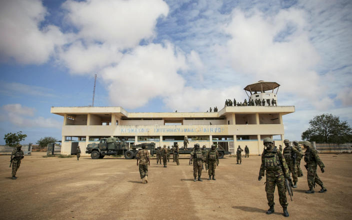 In this photo released by the African Union-United Nations Information Support Team, Kenyan soldiers serving with the African Union Mission in Somalia (AMISOM) secure the airport in Kismayo, southern Somalia, Tuesday, Oct. 2, 2012. Allied African troops have taken full control of Kismayo in Somalia, the last stronghold of al-Shabab Islamist rebels who have been fighting against the country's internationally backed government, a Kenyan military official said Tuesday, and Kenya Defence Forces and the Somali National Army are now patrolling the streets. (AP Photo/AU-UN IST, Stuart Price)
