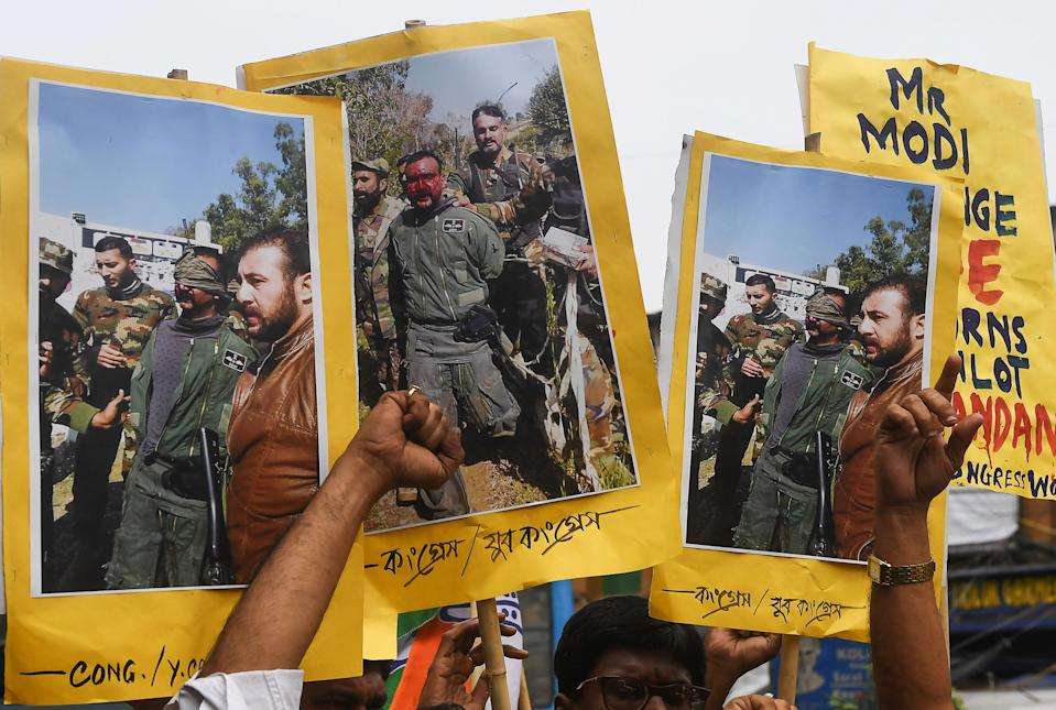 Congress activists shout slogans against Pakistan as they hold posters and pictures of captive Indian Air Force pilot Abhinandan Varthaman, demanding his speedy release in Kolkata on February 28, 2019. (DIBYANGSHU SARKAR/AFP via Getty Images)