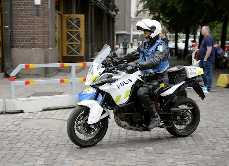 REFILE - UPDATING SLUG Finnish police patrols on motorbike after stabbings in Turku, in Central Helsinki, Finland August 18, 2017. LEHTIKUVA/Linda Manner via REUTERS     ATTENTION EDITORS - THIS IMAGE WAS PROVIDED BY A THIRD PARTY. NOT FOR SALE FOR MARKETING OR ADVERTISING CAMPAIGNS. NO THIRD PARTY SALES. NOT FOR USE BY REUTERS THIRD PARTY DISTRIBUTORS. FINLAND OUT. NO COMMERCIAL OR EDITORIAL SALES IN FINLAND.