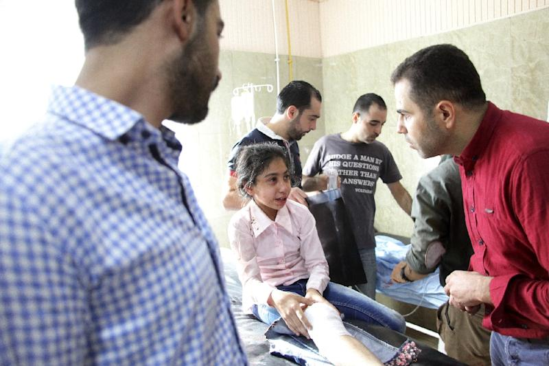 An injured Syrian child receives treatment at al-Razi hospital (AFP Photo/George Ourfalian)
