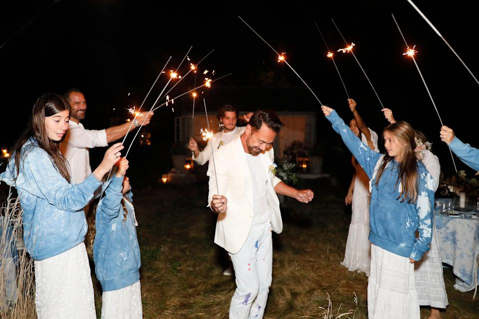 """""""Our family friends who attended, Helen and Charley Melamed, brought giant sparklers. This ended up becoming one of the most fun and spontaneous moments of the night,"""" Nicholas says. """"The adults loved it just as much as the kids."""""""
