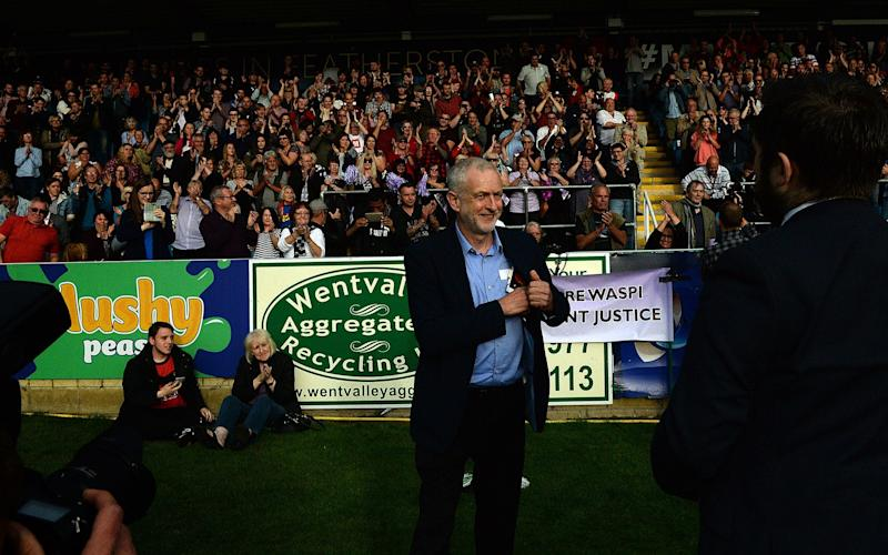 Jeremy Corbyn at a rally - Credit: Getty