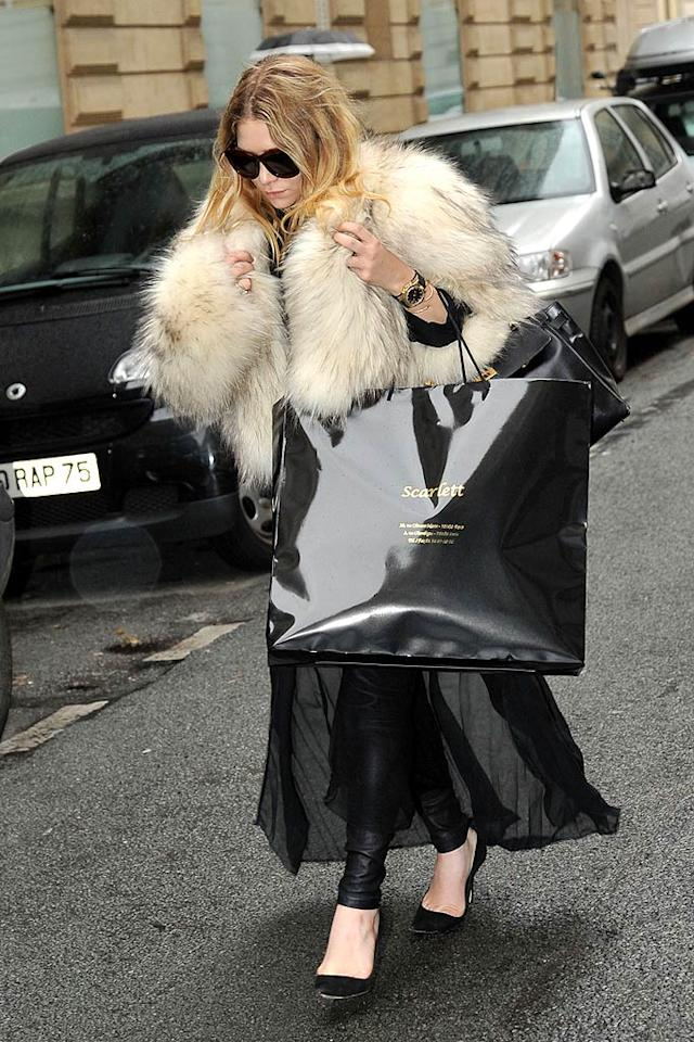 """Hopefully Mary-Kate Olsen's shopping bag doesn't contain yet another jacket made from the coats of cute little animals. <a href=""""http://www.infdaily.com"""" target=""""new"""">INFDaily.com</a> - October 6, 2010"""