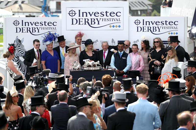 Jockey Seamie Heffernan and trainer Aidan O'Brien with winning connections collect the trophy for winning the Investec Derby after Anthony Van Dyck's success in 2019.