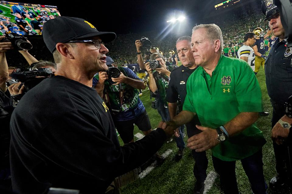 Michigan Wolverines head coach Jim Harbaugh shakes hands with Notre Dame Fighting Irish head coach Brian Kelly after their 2018 game. (Getty)