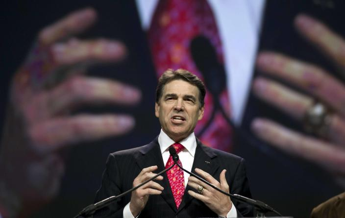 FILE - In this Aug. 6, 2011 file photo, Texas Gov. Rick Perry speaks at The Response, a call to prayer for a nation in crisis, in Houston. Perry attended the daylong prayer rally despite criticism that the event inappropriately mixes religion and politics. Perry announced Monday, July 8, 2013, that he would not seek re-election as Texas governor next year. (AP Photo/David J. Phillip, File)