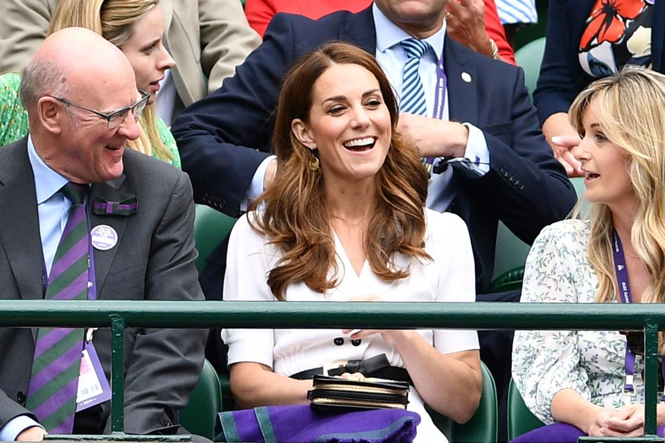 Britain's Catherine, Duchess of Cambridge (C) sits in the crowd on No 1. Court at The All England Tennis Club in Wimbledon, southwest London, on July 2, 2019, on the second day of the 2019 Wimbledon Championships tennis tournament. (Photo by Daniel LEAL-OLIVAS / AFP) / RESTRICTED TO EDITORIAL USE        (Photo credit should read DANIEL LEAL-OLIVAS/AFP/Getty Images)