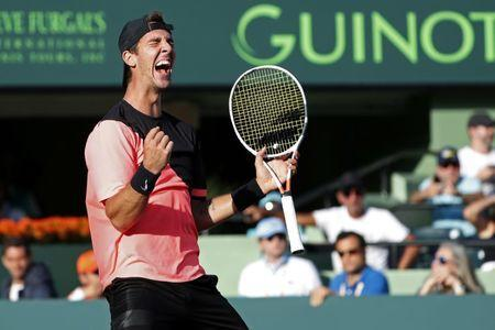 Mar 24, 2018; Key Biscayne, FL, USA; Thanasi Kokkinakis of Australia celebrates after match point against Roger Federer of Switzerland (not pictured) on day five of the Miami Open at Tennis Center at Crandon Park. Kokkinakis won 3-6, 6-3, 7-6(4). Mandatory Credit: Geoff Burke-USA TODAY Sports