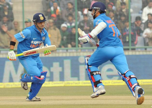 Ajinkya Rahane and Gautam Gambhir of India taking a single against Pakistan during the 3rd One Day Internationals Match between India & Pakistan at Ferozeshah Kotla Stadium in Delhi on January 6, 2013. P D Photo by Manoj