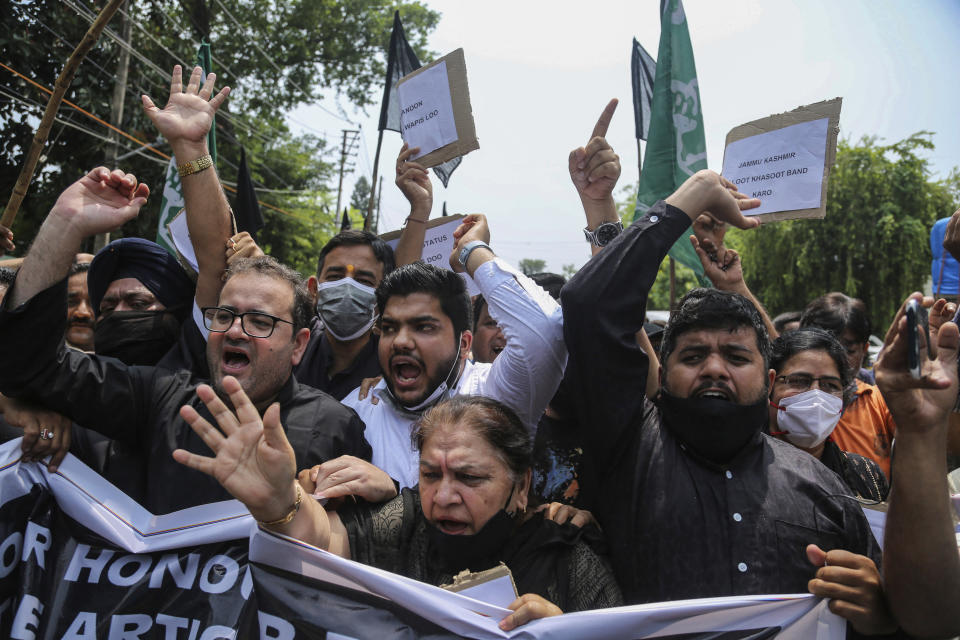Activists of Peoples Democratic Party shout slogans during a protest marking the second anniversary of Indian government scrapping Kashmir's semi- autonomy in Jammu, India, Thursday, Aug.5, 2021. On Aug. 5, 2019, Indian government passed legislation in Parliament that stripped Jammu and Kashmir's statehood, scrapped its separate constitution and removed inherited protections on land and jobs. (AP Photo/Channi Anand)