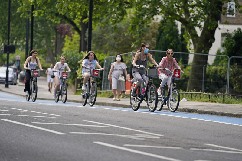 People ride bicycles in a cycle lane in Chelsea, London, after the government unveiled a further ??250 million for extra cycle lanes as the UK prepares for the lifting of the coronavirus lockdown in England.