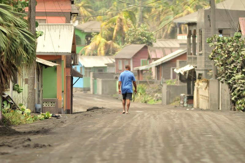 A man walks down a street after a series of eruptions from La Soufriere volcano