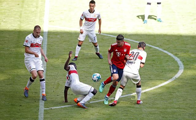 Soccer Football - Bundesliga - Bayern Munich v VfB Stuttgart - Allianz Arena, Munich, Germany - May 12, 2018 Bayern Munich's James Rodriguez in action with Stuttgart's Christian Gentner and Orel Mangala REUTERS/Michaela Rehle DFL RULES TO LIMIT THE ONLINE USAGE DURING MATCH TIME TO 15 PICTURES PER GAME. IMAGE SEQUENCES TO SIMULATE VIDEO IS NOT ALLOWED AT ANY TIME. FOR FURTHER QUERIES PLEASE CONTACT DFL DIRECTLY AT + 49 69 650050
