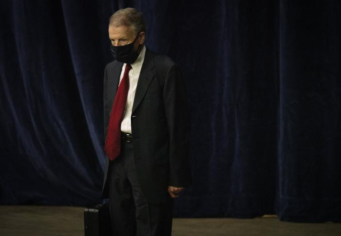 """FILE - In this Jan. 8, 2021, file photo, Illinois House Speaker Michael Madigan walks on the floor as the Illinois House of Representatives convenes at the Bank of Springfield Center, in Springfield, Ill. Speaker Madigan on Monday, Jan. 11, 2021, said he was """"suspending"""" his campaign for a 19th term in the leadership post. Madigan, the longest-serving leader of a legislative body in U.S. history, issued a statement that began, """"This is not a withdrawal."""" But it urged House Democrats to """"work to find someone, other than me, to get 60 votes for speaker."""" (E. Jason Wambsgans/Chicago Tribune via AP File)"""