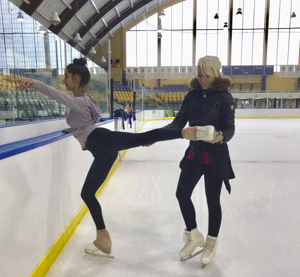 """In this June 3, 2018, photo provided by Championship Figure Skating Camp, skater Isabella Melendez, left, is coached by Rosie Tovi at Essex County Codey Arena in West Orange, N.J. The figure skating coach believes _ and she has many supporters throughout the ice world _ an emphasis on """"happy and healthy"""" should take precedence over turning the sport into gymnastics in a rink. The longtime coach and choreographer calls it a holistic approach. """"Holistic is a perfect word, because it is the whole,"""" says Tovi, who will be launching her Championship Figure Skating Camp at the Essex County Codey Arena in West Orange on June 25. (Elise Nelson/Championship Figure Skating Camp via AP)"""