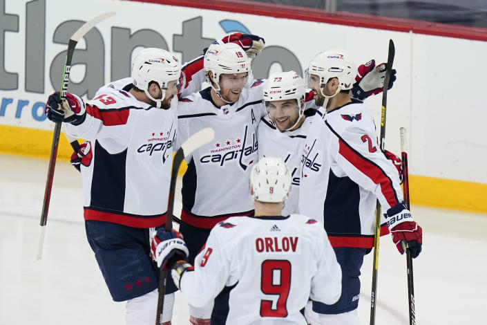 Washington Capitals' Conor Sheary (73) celebrates with Justin Schultz (2), Nicklas Backstrom (19), Dmitry Orlov (9) and Tom Wilson (43) after scoring a goal during the second period of the tema's NHL hockey game against the New Jersey Devils on Sunday, April 4, 2021, in Newark, N.J. (AP Photo/Frank Franklin II)