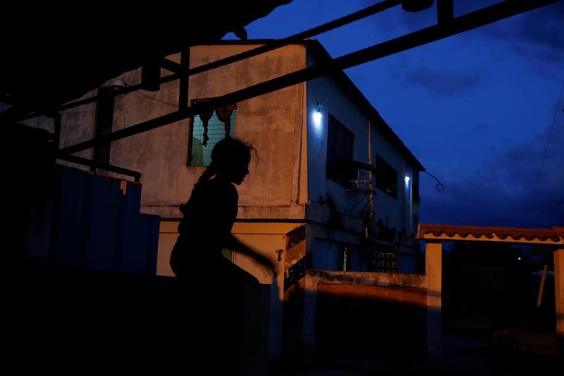 Aranza, sister of Maroly Bastardo, plays outside the family house in El Tigre, Venezuela, on June 3. (Photo: Ivan Alvarado/Reuters)