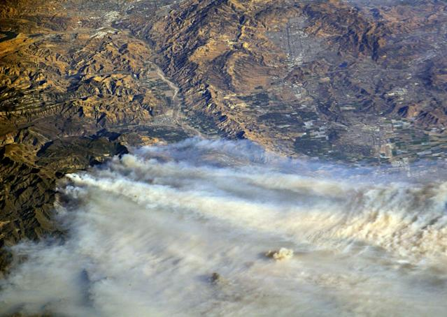 <p>A photo taken from the International Space Station and moved on social media by astronaut Randy Bresnik shows smoke rising from wildfire burning in Southern California, (Photo: @AstroKomrade/NASA/Handout via Reuters) </p>