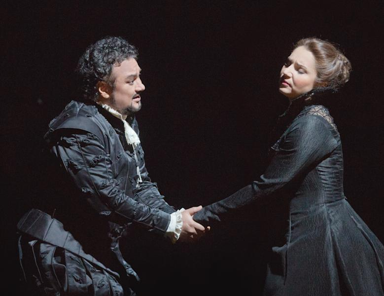 """In this Feb. 14, 2013 photo provided by the Metropolitan Opera, Ramón Vargas plays Don Carlo and Barbara Frittoli is Elisabeth de Valois during a dress rehearsal of """"Don Carlo"""" at the Metropolitan Opera in New York. (AP Photo/Metropolitan Opera, Ken Howard)"""