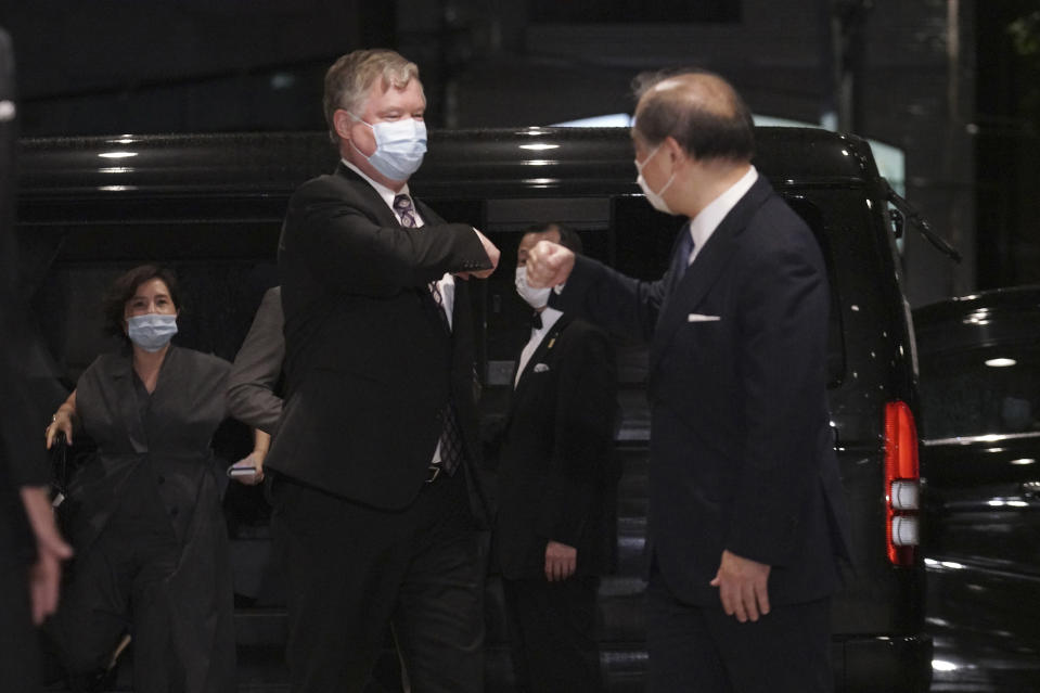 U.S. Special Representative for North Korea Stephen Biegun, left, and Japanese Vice Foreign Minister Takeo Akiba, right, greet each other prior to their bilateral meeting at Iikura Guest House Thursday, July 9, 2020, in Tokyo. (AP Photo/Eugene Hoshiko, Pool)