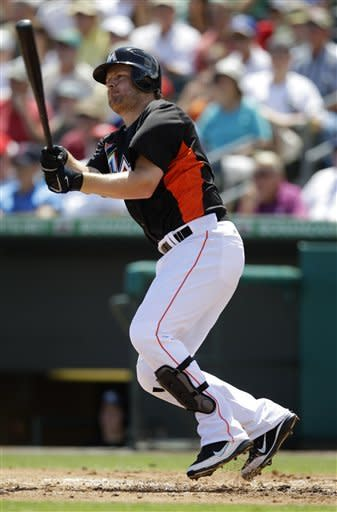 Miami Marlins' Austin Kearns hits a double in the first inning of a spring training baseball game against the Washington Nationals in Jupiter, Fla., Tuesday, March 27, 2012. Hanley Ramirez and Gaby Sanchez scored on the play. Miami won 3-1. (AP Photo/Patrick Semansky)
