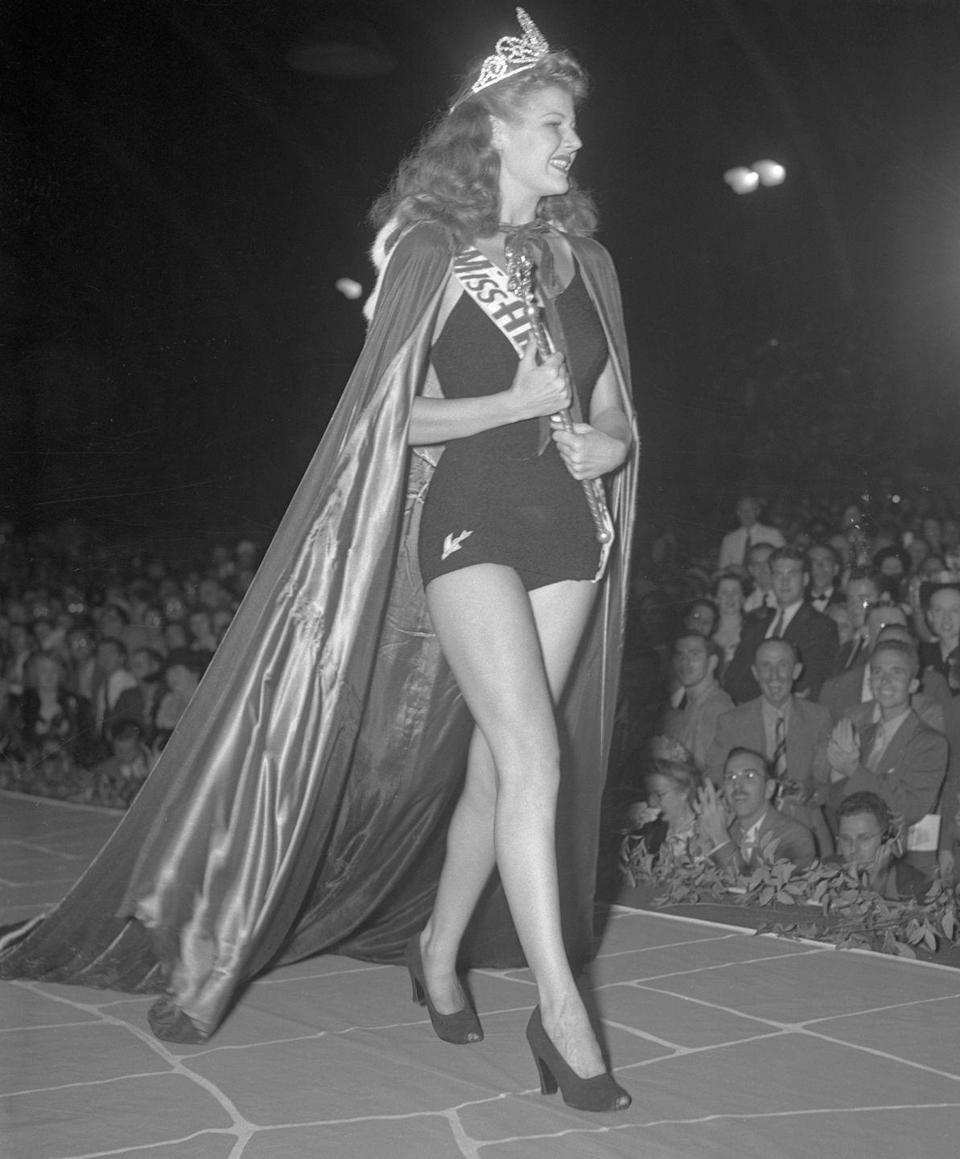 <p>Rosemary LaPlanche from California wowed the crowd in a dark bathing suit and voluminous curls at the pageant in 1941. </p>
