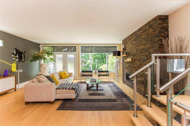 <p><span>546 Hilson Avenue, Ottawa, Ont.</span><br> The modern, open-concept home has hardwood floors throughout and a gas fireplace nestled in a cultured stone wall.<br> (Photo: Zoocasa) </p>
