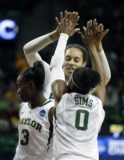Baylor'S Odyssey Sims (0), Jordan Madden (3) and Brittney Griner, rear, celebrate scoring against Prairie View A&M in the second half of a first-round game in the women's NCAA college basketball tournament Sunday, March 24, 2013, in Waco, Texas. Baylor won 82-40. (AP Photo/Tony Gutierrez)