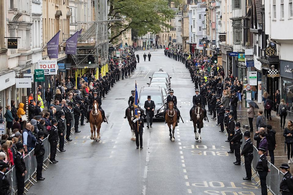 File photo dated 14/10/19 of members of the public lining the High Street in Oxford to pay their respects as the funeral cortege for PC Andrew Harper, who died from multiple injuries after being dragged under a van while responding to reports of a burglary, makes its way to Christ Church Cathedral in St Aldate's, Oxford. Driver Henry Long, 19, has been found not guilty at the Old Bailey of murder, but had ealier pleaded guilty to manslaughter. His passengers Jessie Cole and Albert Bowers, both 18, were cleared of murder but found guilty of manslaughter for the death of Pc Andrew Harper, who had been attempting to apprehend quad bike thieves when he was killed on the night of August 15, 2019.