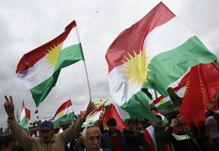People carry Kurdistan flags during a May Day demonstration in Istanbul