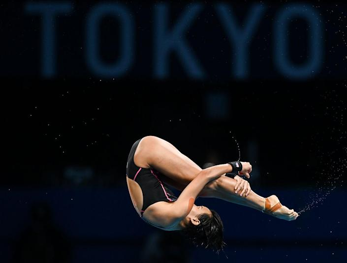 <p>Jun Hoong Cheong of Malaysia in action during the preliminary round of the women's 10 meter platform.</p>