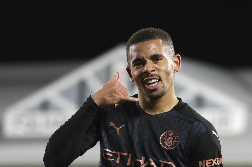Manchester City's Gabriel Jesus celebrates after scoring his side's second goal during an English Premier League soccer match between Fulham and Manchester City at the Craven Cottage stadium in London, England, Saturday March 13, 2021. (Catherine Ivill/Pool via AP)
