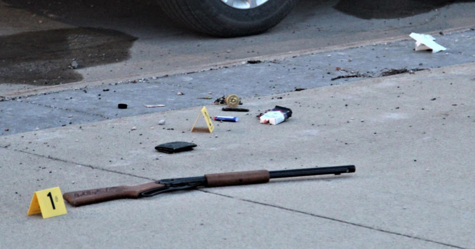 Items on the sidewalk at the scene of an officer-involved shooting at the foot of the Sixth Street bridge early Wednesday, April 7, 2021, in Waterloo, Iowa. In a lawsuit filed Thursday, Sept. 23, 2021, a man who was paralyzed when an Iowa police officer shot him in April is suing the officer. Marcelino Alvarez-Victoriano contends the shooting was not justified. Authorities say a Waterloo police officer shot Alvarez-Victoriano after he pointed a pellet gun that looked like a shotgun at two Black Hawk County sheriff's deputies. (Jeff Reinitz/The Courier via AP)