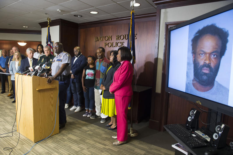Baton Rouge area law enforcement officials including BRPD Chief Murphy Paul, at lectern, announce the arrest of Ronn Jermaine Bell, 38, shown on monitor at right, Tuesday July 16, 2019 in the recent murder of community activist and Baton Rouge African-American History Museum founder Sadie Roberts-Joseph.  (Travis Spradling/The Advocate via AP)