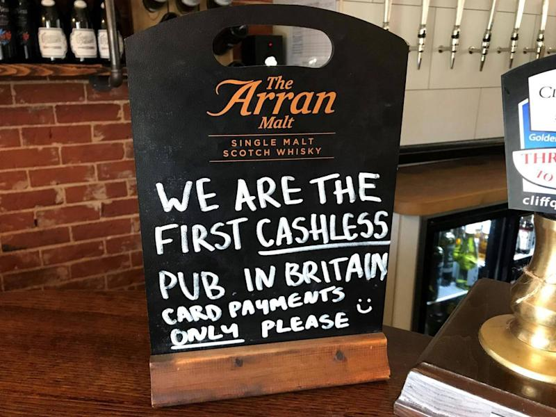 A sign on the bar of the Boot pub in Freston near Ipswich, Suffolk (PA)