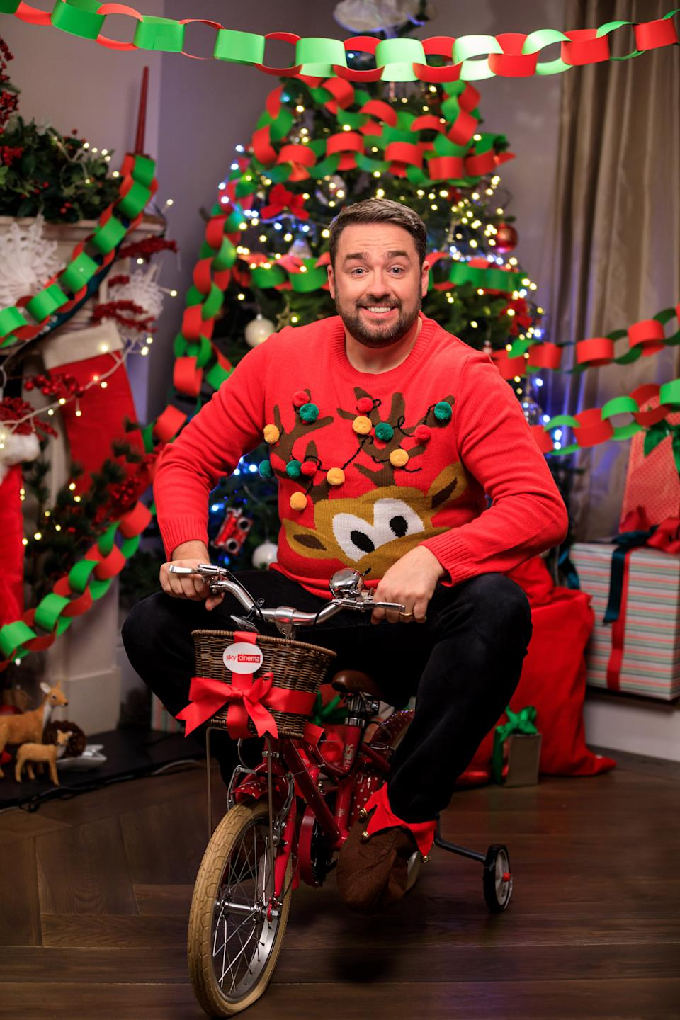 Jason Manford getting in the spirit of Buddy from the film Elf to celebrate the movie coming to Sky Cinema on December 8 (Sky Cinema/PA)