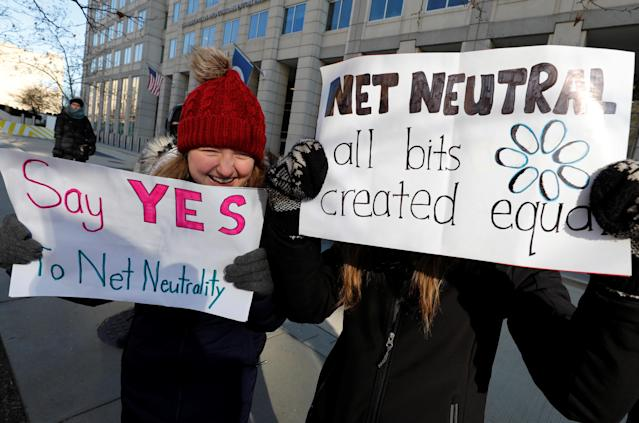 Net neutrality advocates rally in front of the Federal Communications Commission (FCC) ahead of Thursday's expected FCC vote repealing so-called net neutrality rules in Washington, U.S., December 13, 2017. REUTERS/Yuri Gripas