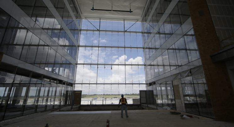 In this photo made Friday, June 3, 2016, work continues on offices at the new Dallas Cowboys headquarters in Frisco, Texas. The development, named The Star, will be home to the Cowboys' offices, two outdoor practice fields and a 12,000-seat indoor stadium that will be shared with the Frisco Independent School District. It will include retail shopping and an upscale 16-story hotel with a convention center. (AP Photo/LM Otero)