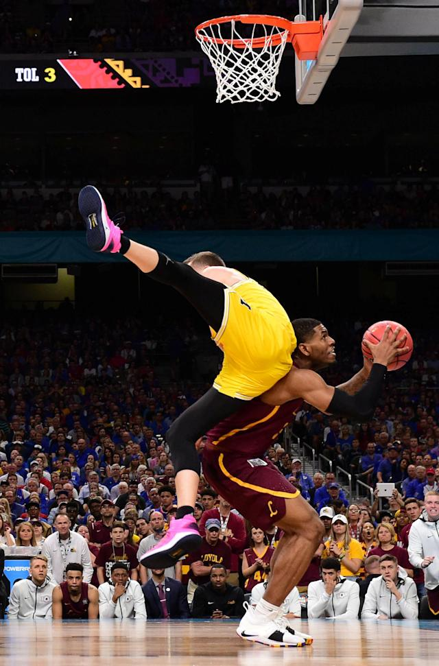 Mar 31, 2018; San Antonio, TX, USA; Loyola Ramblers forward Aundre Jackson (24) is fouled by Michigan Wolverines guard Duncan Robinson (22) during the second half in the semifinals of the 2018 men's Final Four at Alamodome. Mandatory Credit: Bob Donnan-USA TODAY Sports TPX IMAGES OF THE DAY