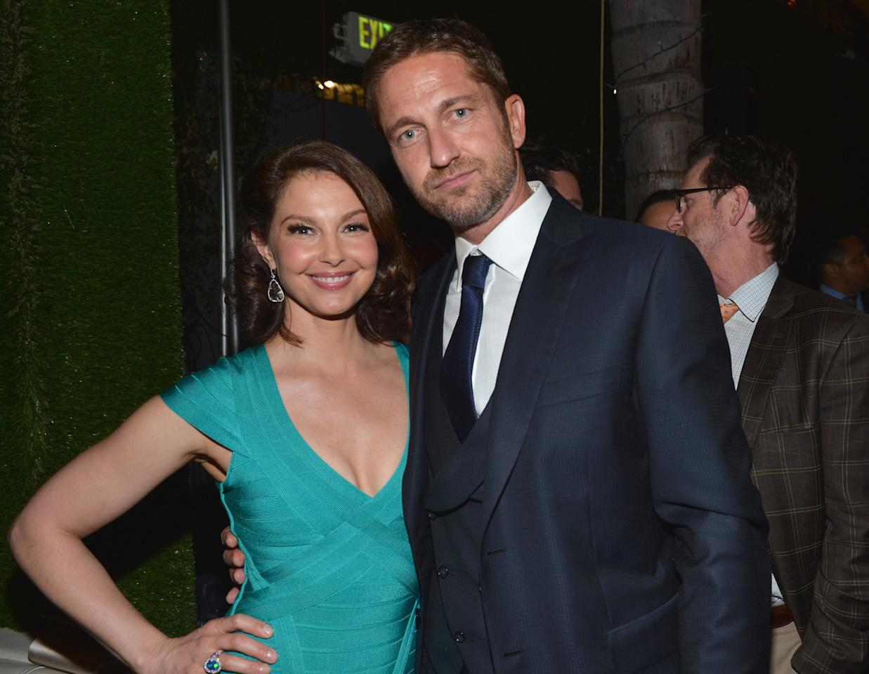 "HOLLYWOOD, CA - MARCH 18:  Actors Ashley Judd and Gerard Butler attend the after party for the premiere of FilmDistrict's ""Olympus Has Fallen"" at Lure on March 18, 2013 in Hollywood, California.  (Photo by Alberto E. Rodriguez/Getty Images)"