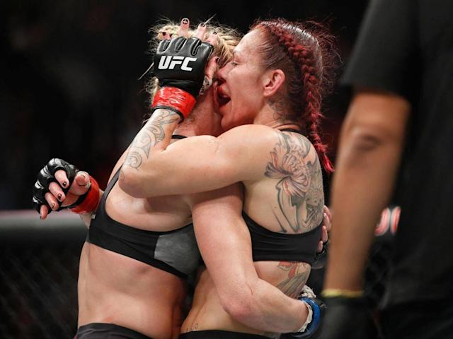 Holm and Cyborg embrace after the final hooter (AP)