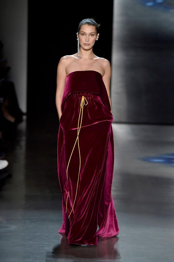 <p>Model Bella Hadid wears a wine-colored strapless gown at the Prabal Gurung FW18 show. (Photo: Getty) </p>