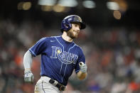 Tampa Bay Rays' Brandon Lowe smiles as he runs the bases after hitting a two-run home run against the Houston Astros during the sixth inning of a baseball game Thursday, Sept. 30, 2021, in Houston. (AP Photo/David J. Phillip)