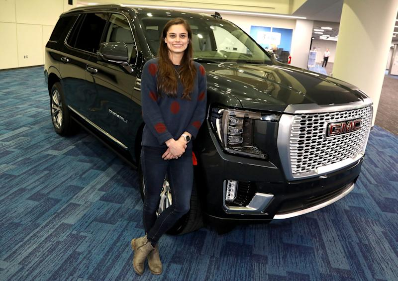 General Motors engineer Alex Archer with the 2021 GMC Yukon on Thursday, January 23, 2020 that she had a role in designing part of the interior. Archer worked on the new and innovative power console that with the push of a button can slide back and forth to revel lots of storage space giving owners an extra 10-cubic inches of storage in the popular selling SUV.