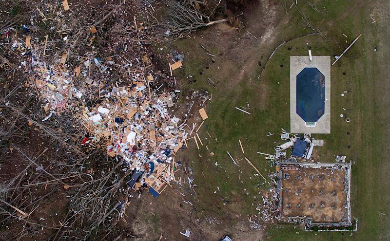 Debris from a home litters a yard the day after a tornado blew it off its foundation, lower right, in Beauregard, Ala., March 4, 2019. (Photo: David Goldman/AP)