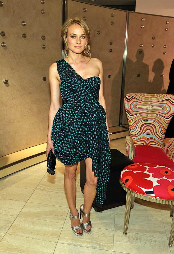 "Diane Kruger (""Inglourious Basterds"") continued to impress us with her sensational style at a fashion fete in Beverly Hills by wearing a one-shoulder Jason Wu masterpiece, Roger Vivier heels, and Eddie Borgo bracelets. John Shearer/<a href=""http://www.wireimage.com"" target=""new"">WireImage.com</a> - October 27, 2009"