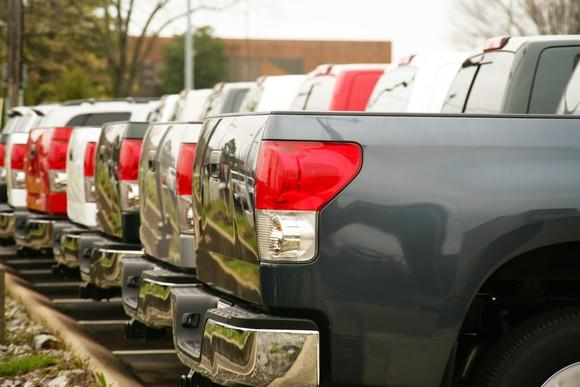 Row of trucks at a dealership lot